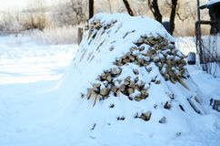 Wood pile covered with snow royalty free stock photography
