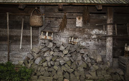 Wood pile. In a front of a very old log house royalty free stock photo