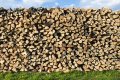Wood pile. On the grass under the sky Royalty Free Stock Photos