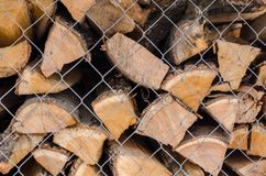 Wooden logs. Wood pile reserve for the winter concept. Pile of chopped firewood from trees. Nature background texture of wood.  Wooden logs wall close up view royalty free stock photography