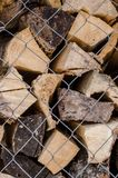 Wooden logs. Wood pile reserve for the winter concept. Pile of chopped firewood from trees. Nature background texture of wood.  Wooden logs wall close up view royalty free stock photo