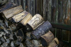 Wood pile. Wood stacked with wood fence boards in background Stock Images