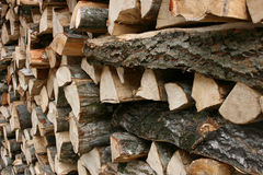 Wood piles. Wood storage for heating during the winter Stock Photos