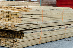Wood piles for construction. Piles of wood ready for construction to build in a lumber yard Stock Photography