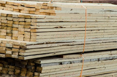 Wood piles for construction shipped Royalty Free Stock Images