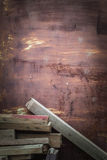 Wood piles on iron door. Wood piles and rusted old iron door Royalty Free Stock Photography