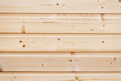 Wood pine planks. Wood pine planks lite brown texture fragment as a background composition Royalty Free Stock Images