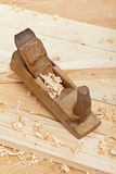 Wood plancks, plane and wooden shavings stock photography