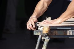 Wood Planer. Carpenter planing wood Royalty Free Stock Photo