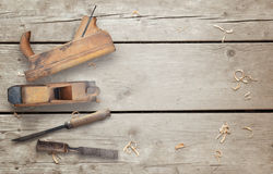 Wood planer and chisel on wooden desk Stock Photos