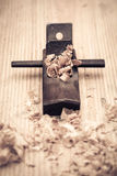 Wood planer and shavings closeup Royalty Free Stock Photo