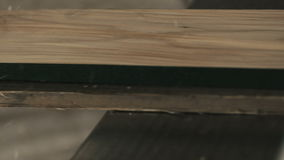 Wood planing tight super slow motion stock footage