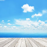 Wood plank as a pier on blue sea & sky background Stock Photos