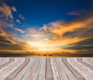 Wood plank as a pier or deck on blue sea water and sky Royalty Free Stock Image