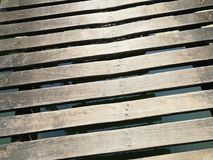Wood plank as walkway in the local place. Wood plank walkway local place wooden lines stock images
