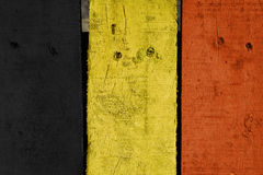 Wood plank with Belgian flag color painted background Royalty Free Stock Images