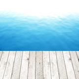 Wood plank on blue water background Stock Photos