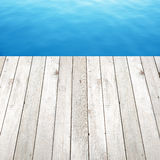 Wood plank on blue water background Royalty Free Stock Images