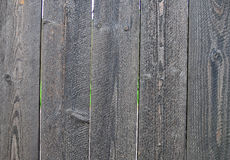 Wood plank fence. Weathered wood plank fence closeup royalty free stock photos