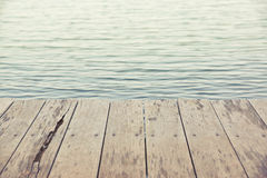 Wood plank floor on water. Surface background in vintage tone stock photo
