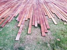 Wood plank on grass horizontal Stock Photography
