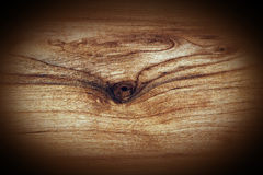 Wood plank with knot background. Hard wood plank with knot grungy background with dark vignette Royalty Free Stock Photos