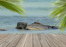 Wood plank over beach with coconut palm tree Stock Photo