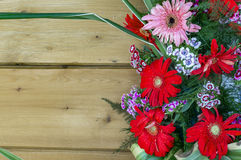 Wood plank with red and pink flowers Royalty Free Stock Image