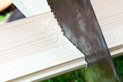 Wood plank sawing Royalty Free Stock Photos