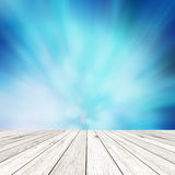 Wood plank on shiny abstract blue background Stock Photography