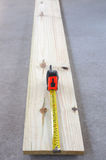 Wood plank and tape measure. Wide angle view Stock Photo