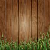 Wood plankor och bakgrund för grönt gräs Royaltyfri Foto