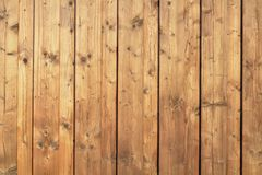 Wood planks. Brown wood planks background in vertical lines Royalty Free Stock Photos