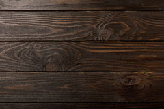 Wood planks a dark brown color background. Stock Photo