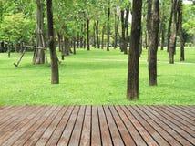 Wood Planks Floor And Green Garden Stock Images
