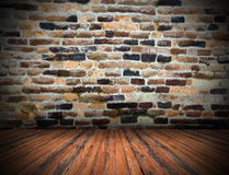 Wood planks floor on cracked indoor backdrop Stock Images