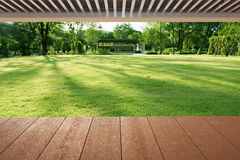 Wood planks floor and roof near the flower garden Stock Image