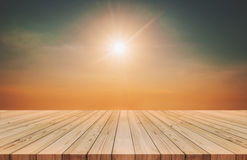 Wood planks floor with sunshine on sky near sunset time in summer background Stock Images