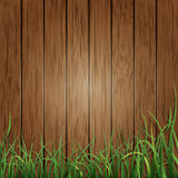 Wood planks and green grass background Royalty Free Stock Photo