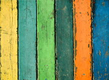 Wood planks painted with paint cracked by a rustic background. Grunge wooden texture in multicolor paint. Color wood background textures.Wood planks painted Royalty Free Stock Images