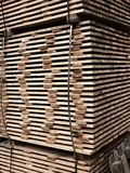 Wood planks for timber construction in stock.  Wooden boards Royalty Free Stock Photography