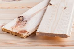 Wood planks are on wooden board with sawdust royalty free stock photos
