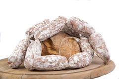 Wood plate with bread and string of sausages Stock Image