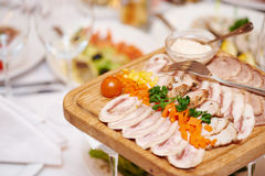 Wood plate with food at restaurant Stock Image
