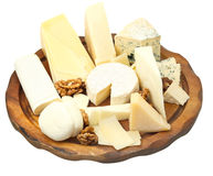 Wood plate with various cheeses Stock Photography