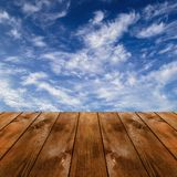 Wood platform and blue sky with clouds Royalty Free Stock Photos