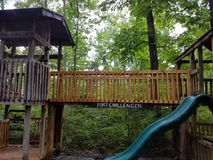 Wood play structure. Named Fort Challenger with slide Stock Image