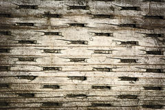 Wood with Pleated Pattern. Detailed close up of a the surface of old wood planking. A great texture image for a background or overlay stock images