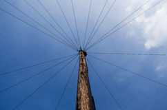 Wood pole and wires. View under a wood pole with many telephone wires Royalty Free Stock Image