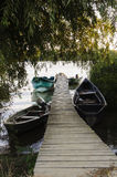 Wood pontoon and boats Royalty Free Stock Photography